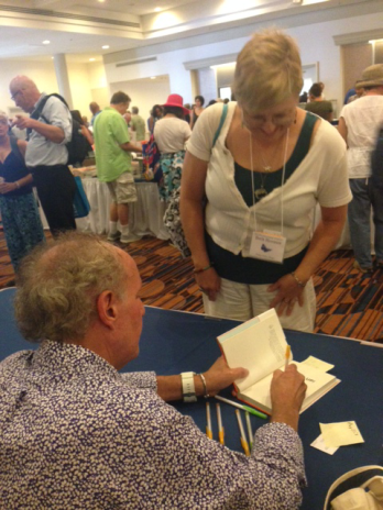 Joey Reiman signs books during The Decatur Book Festival