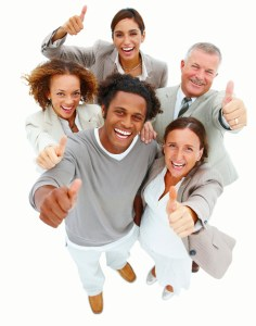 Portrait of smiling business people with thumbs up against white