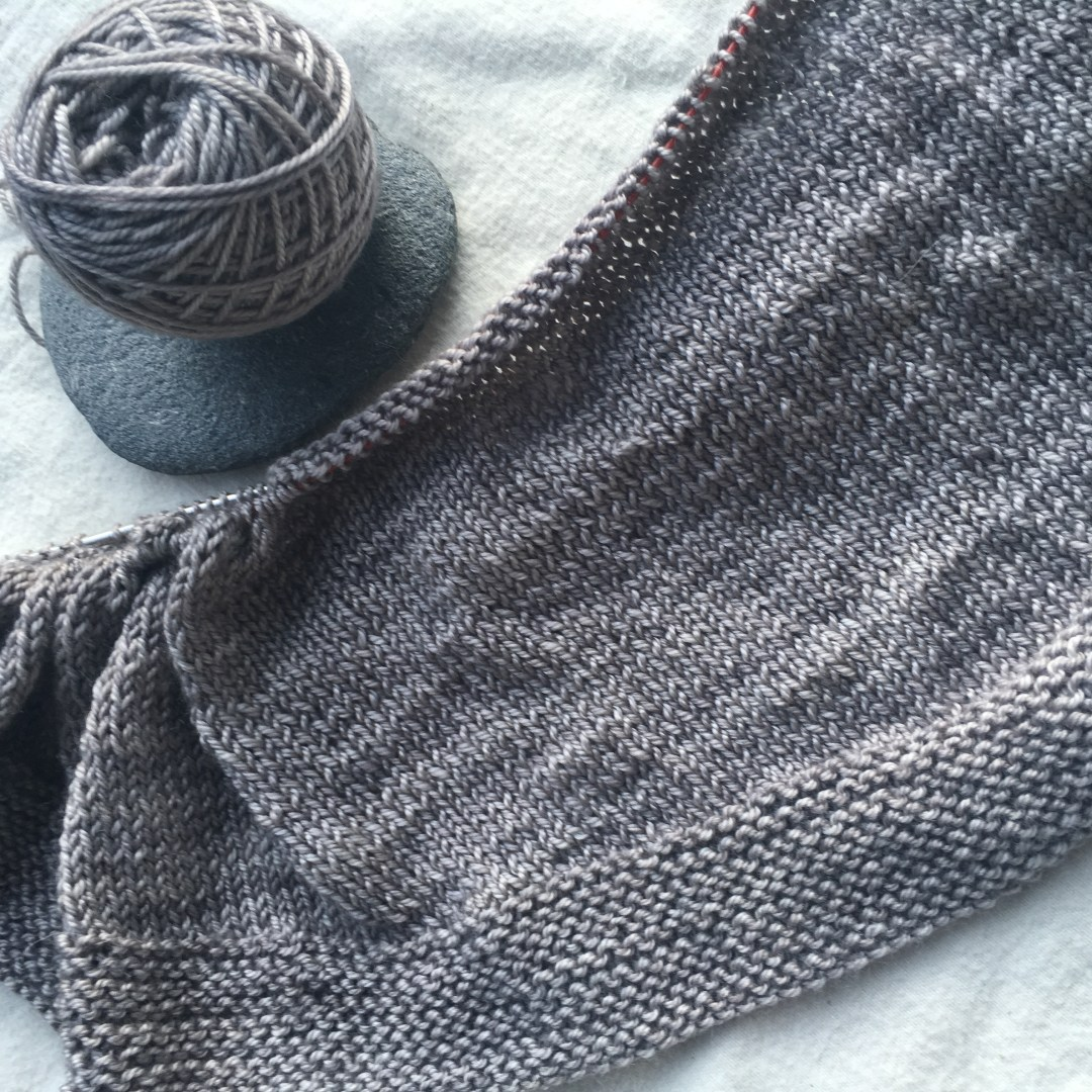 Crescent shawl in the works using Madelinetosh Pasmina in the Kitten colorway. Simple is better.