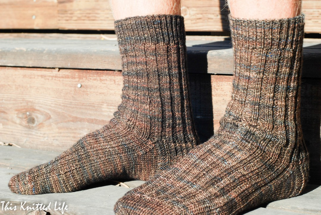 Simple knit man socks in Madelinetosh Tosh Sock in the Whiskey Barrel colorway. Quick and easy beginner sock pattern!
