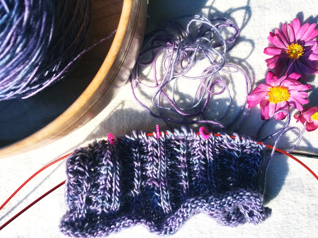 A new baby hat in the works over at This Knitted Life using Madelinetosh Tosh Merino Light.