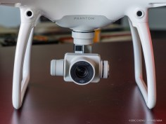 DJI Phantom 4's gimbal-stabilized 4K camera and arm-integrated vision sensors.