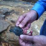 Geophysicist Eric Desaulniers of Ottawa holding natural graphite at his company's Matawinie deposit in Quebec