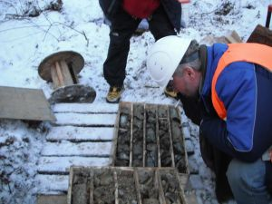 Tom Bowens looks at most recent exploration 'drill core' at Sleeper Zone, Malmyzh Project: Copper & Gold -- TC photo