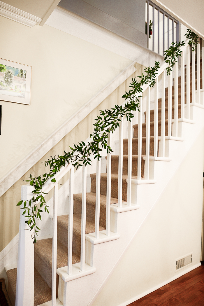 Christmas decorating ideas - Italian ruscus on the stair banister