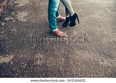 Legs of a young couple in love - stock photo