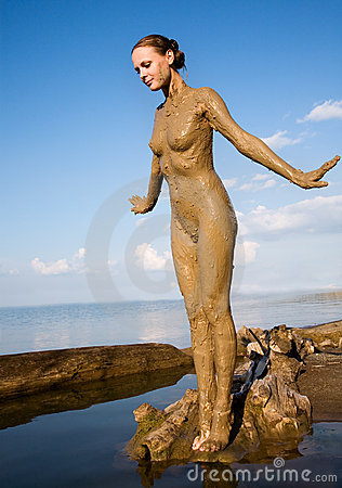 women in muddy dresses