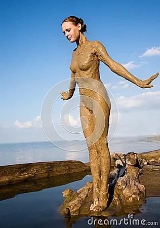 women in muddy dresses