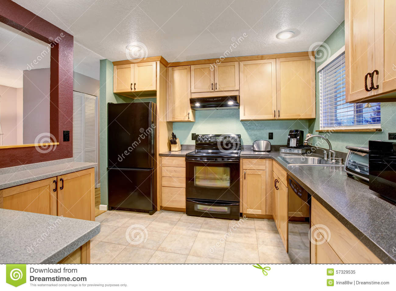 american light wood kitchen interior small house apartment type typical tile floor birch tree cabinets black color 57329535