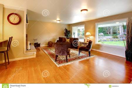 elegant warm color furnished living room wide windows hardwood floor brown velvet couch chairs match light tones walls 36899634