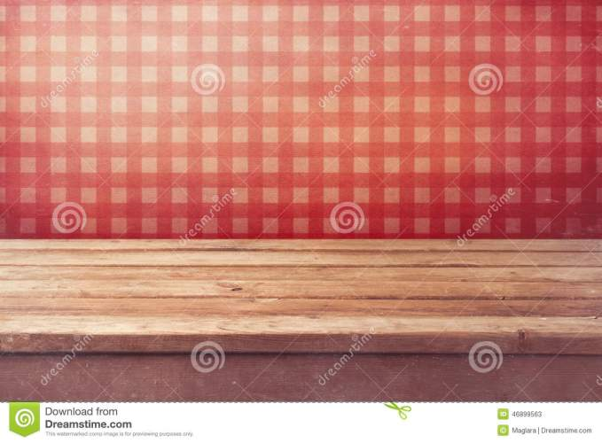 empty wooden deck table over checked red wallpaper vintage kitchen interior ready product montage 46899563