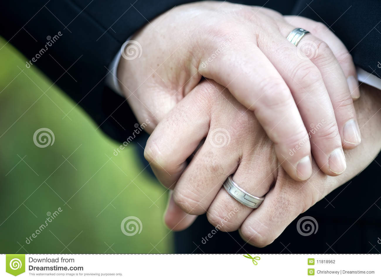 stock photography gay couple holding hands wedding rings image gay wedding bands Gay Couple Holding Hands with Wedding Rings