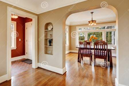 house interior view dining area entrance hall open floor plan wooden table set red wall hallway 42919023