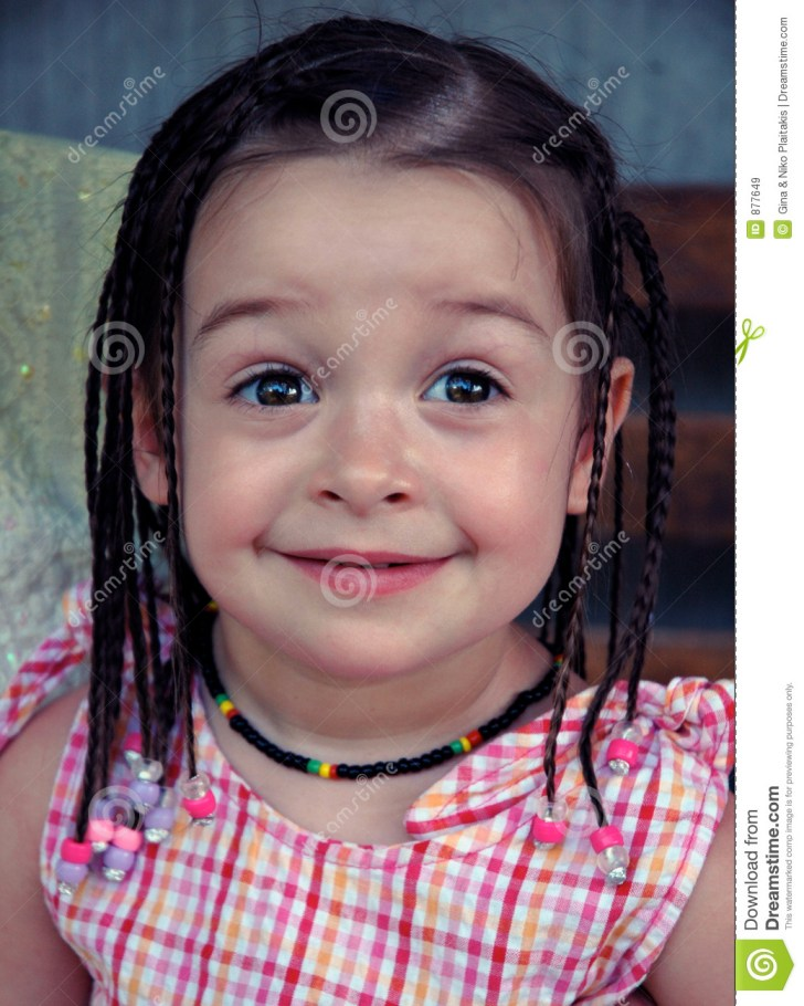 Little Girl Posing With Her New Hairdo While On Vacation In Jamaica