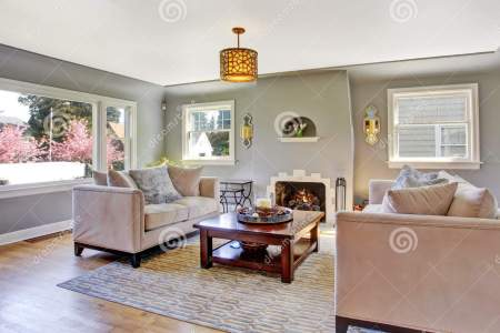 light grey living room white sofas fireplace rom hardwood floor rug furnished wooden coffee table 42628342