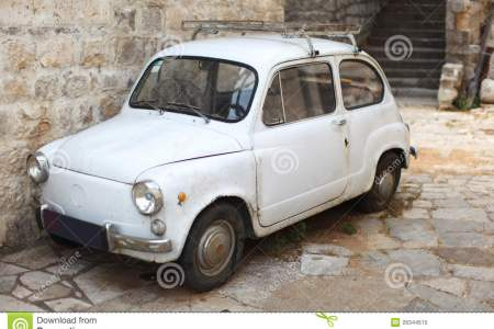 old timer white small italian car parked all 26344515