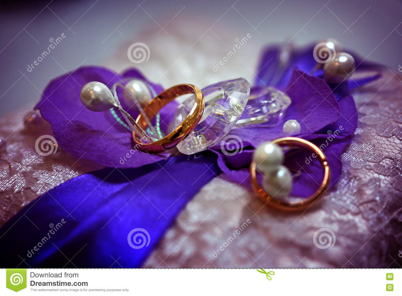 stock photo two golden wedding rings purple background stones lace image purple wedding rings Two golden wedding rings on purple background with stones lace