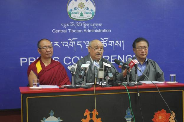 The Chief Election Commissioner (centre) and his deputies announcing the final election results.