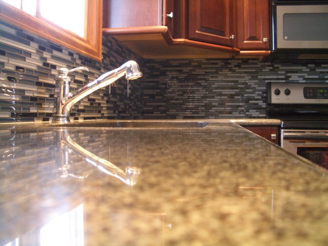 how to pick the perfect grout glass backsplash kitchen Glass backsplash in Fort Collins with light gray grout