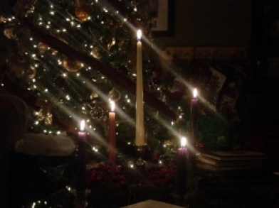 Our Advent wreath, lit on Christmas Eve in 2006, with the Christmas tree behind.
