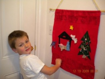 Samuel opening the day's pouch in our Advent Calendar after our daily December devotional