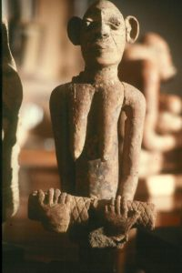 A 14th century statue from Mali of a woman holding a scroll