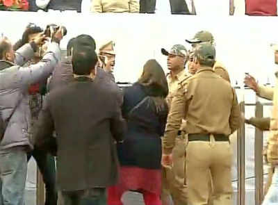 The woman who threw ink towards Arvind Kejriwal is reigned in by security offiicials.