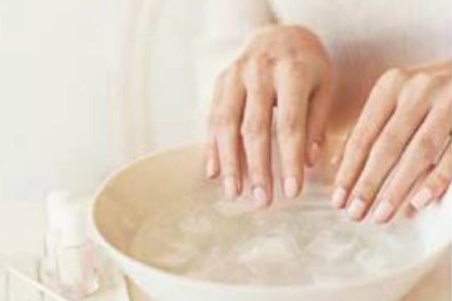 Quickly dry nail polish by dunking them in ice water for three minutes