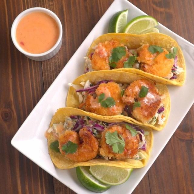 Overhead three sweet chili shrimp tacos on corn tortillas