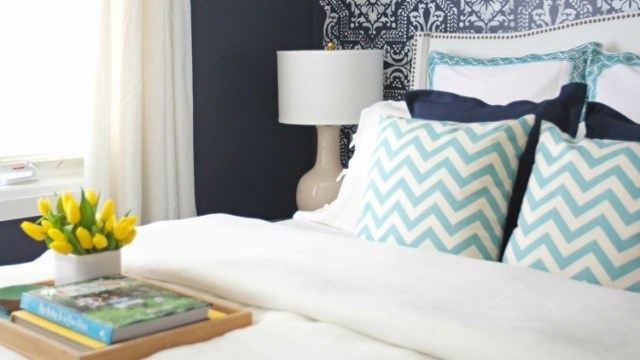 Bed with white, turquoise and navy bedding after makeover