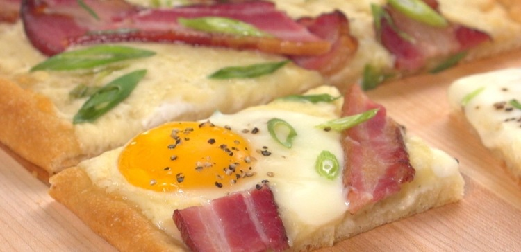 Close-up of bacon and egg breakfast tart pieces