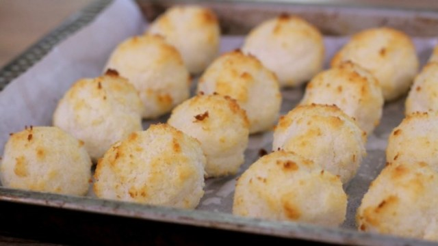 Coconut macaroons baking on sheet pan