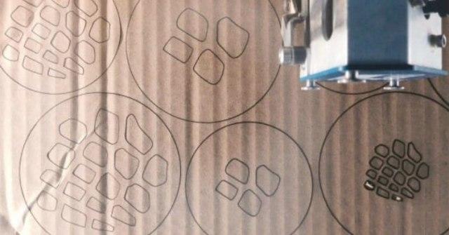 Designs traced on cardboard for mason jar lid inserts