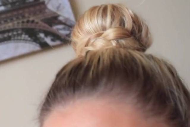 A topknot surrounded by a braid for a quick lazy Monday hairstyle