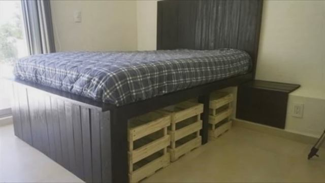 Bed with plenty of storage space made from pallets