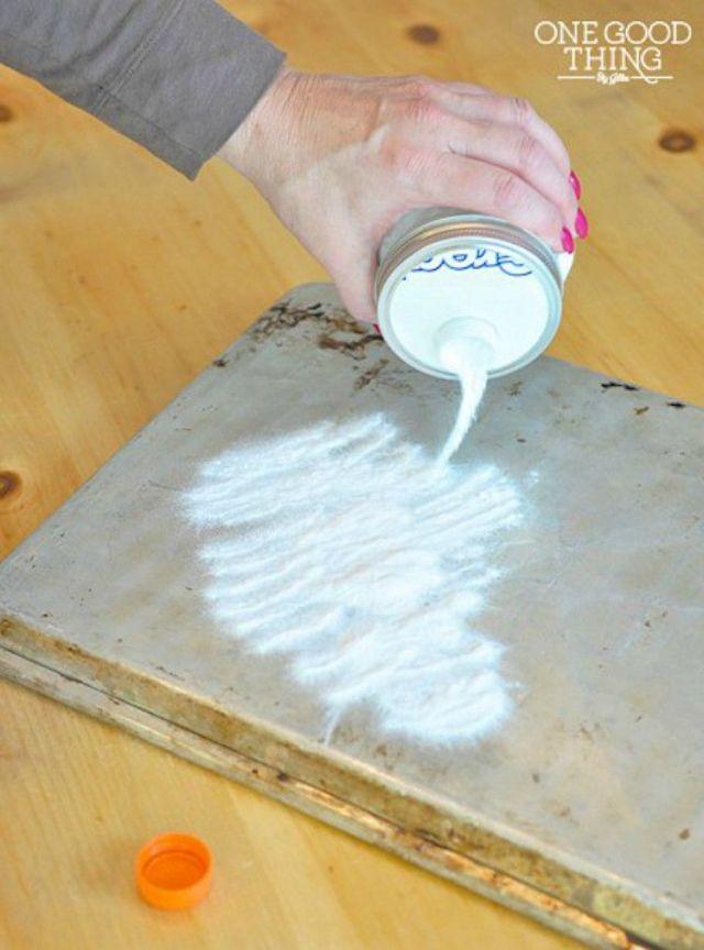 The spigot mason jar pouring out flour.
