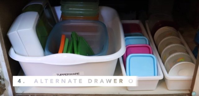 Use dollar store bins to organize containers.