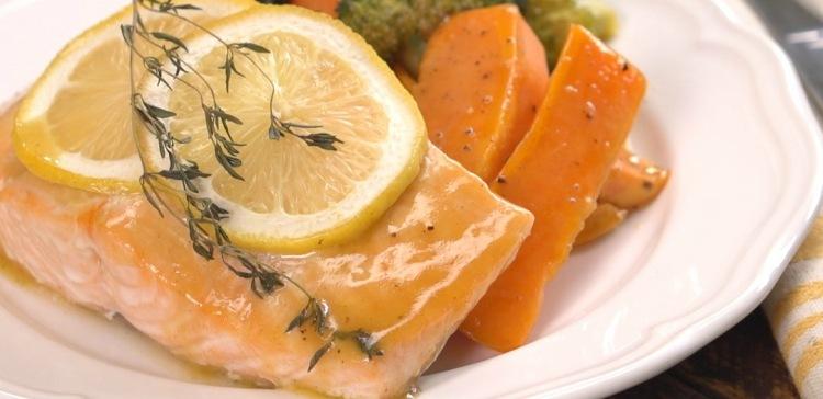 Honey glazed sheet pan salmon on white plate close up