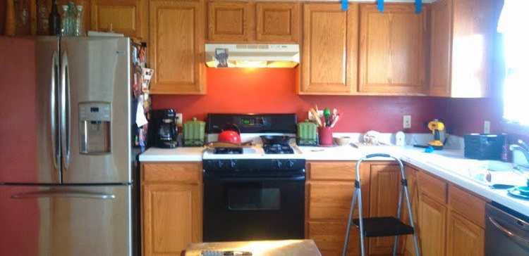Woman remodels her kitchen inexpensively.