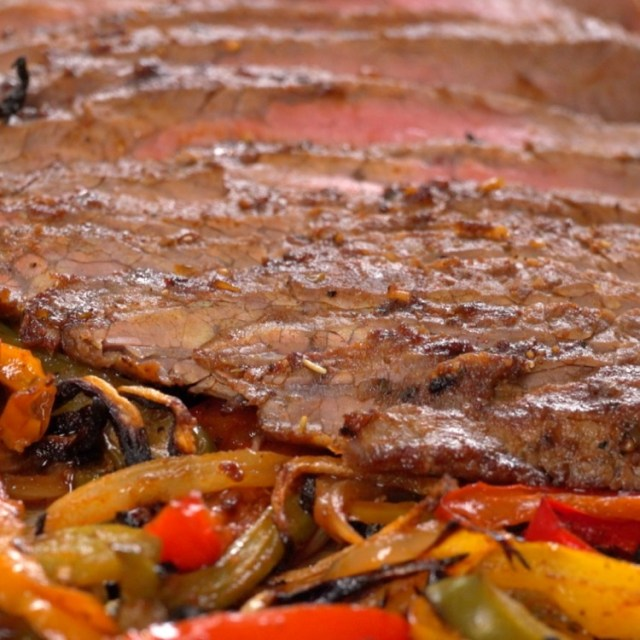 Flank steak broiled with fajita peppers