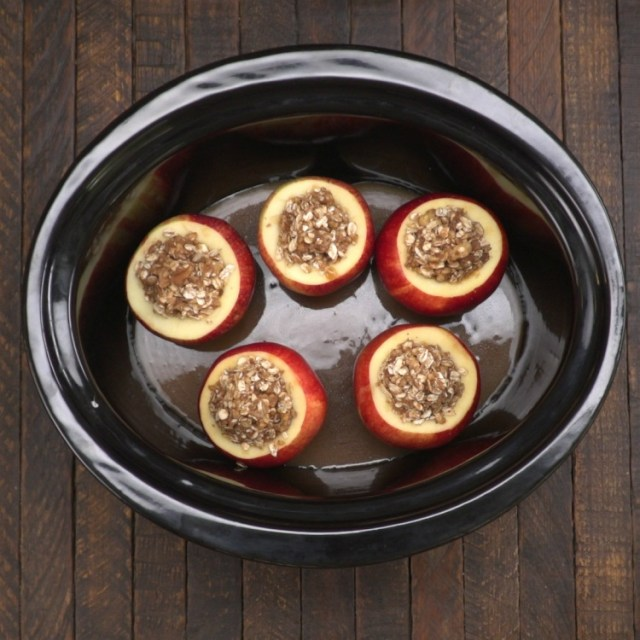 Stuffed apples in slow cooker about to be baked