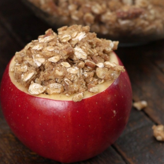 Cinnamon oat pecan crumble atop filled apple