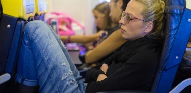 a woman sleeps on an airplane