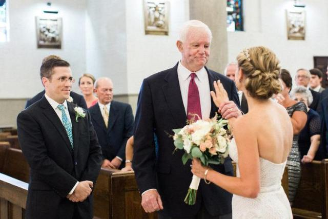Jeni Stepian touches Arthur Stepian's heart during her wedding ceremony