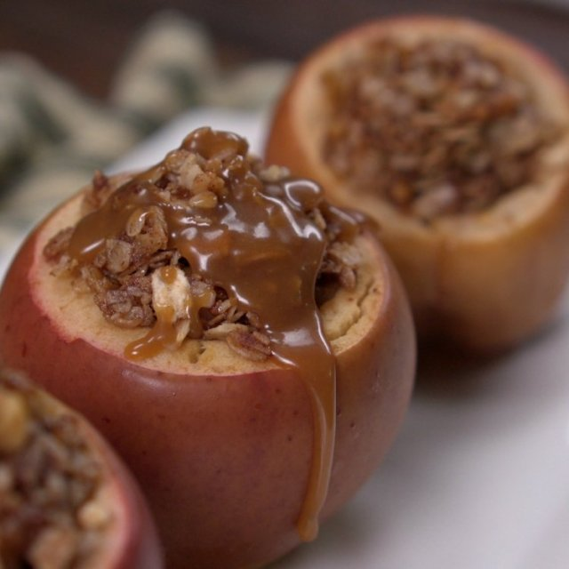Apples baked in slow cooker topped with caramel sauce
