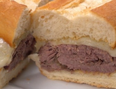 Close-up of slow cooker French dip sandwich