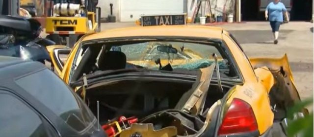 view of a severly smashed taxi
