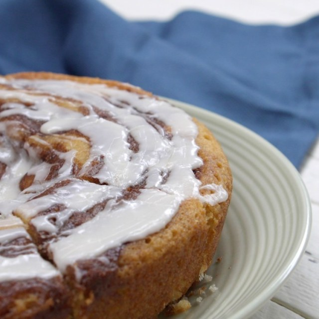 Cinnamon roll cake on white plate