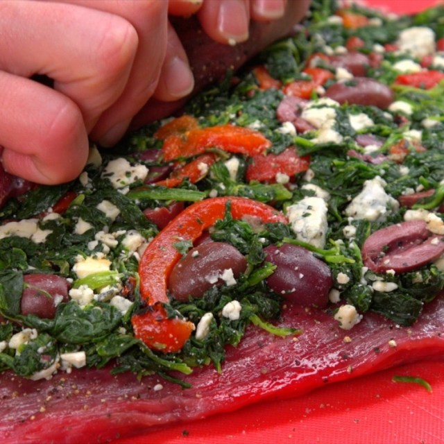 Filling and rolling flank steak roulade
