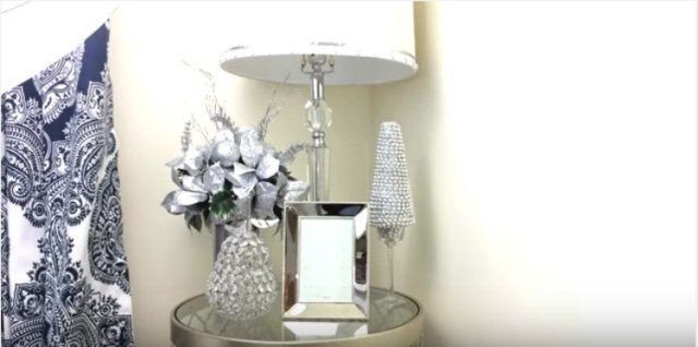 display of Christmas decorations with mini tree on table